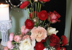Red and peach ranunculus with red roses and million star gyp makes a wonderful statement for Valentine's Day.