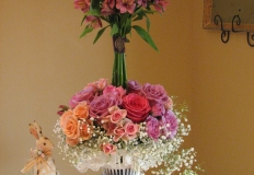 Peach Alstromeria with spray roses in lavender and coral on top of a cloud of Baby's Breath, stunning!